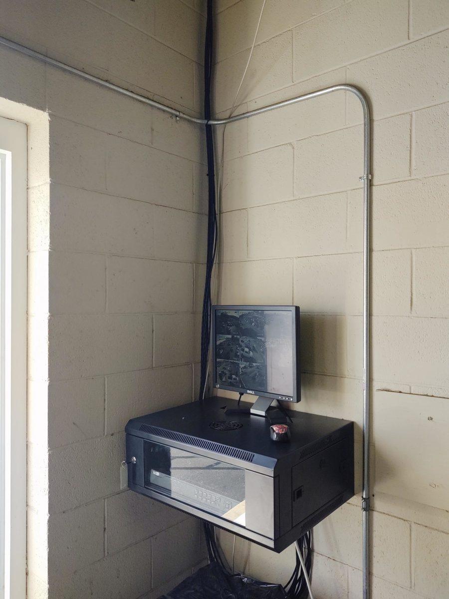 Installing outdoor cameras at Suttle Automotive | Newport News, VA